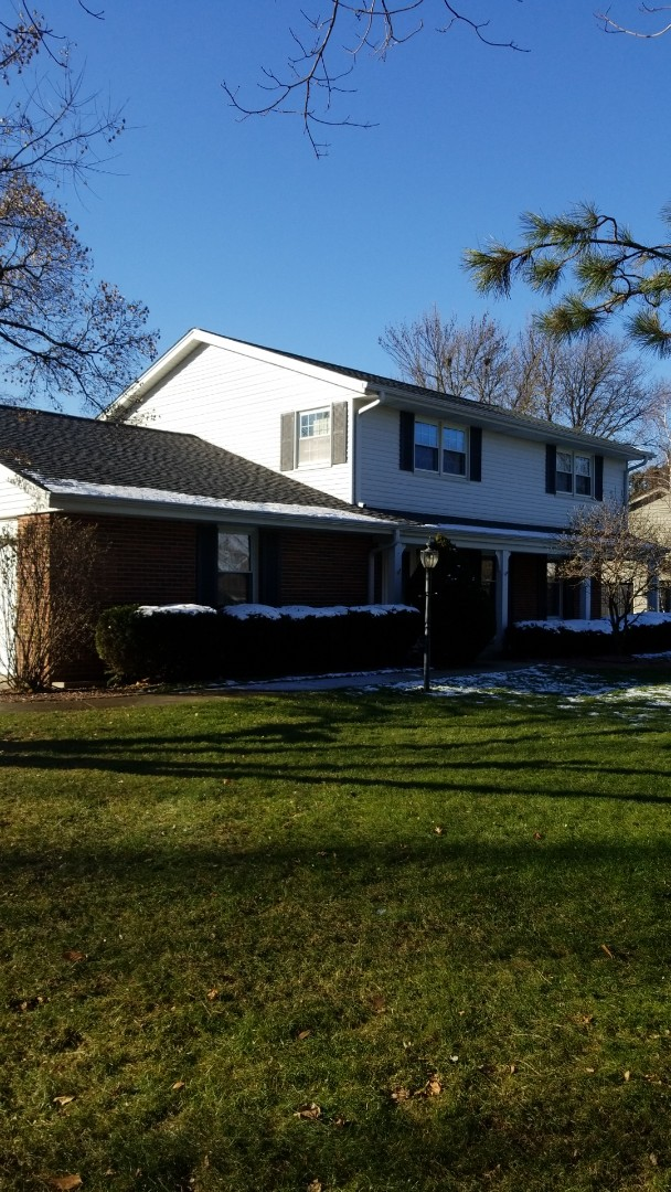 Brookfield, WI - New roof on two story colonial home in Brookfield WI. GAF Timberline HD single. Color is pewter gray.