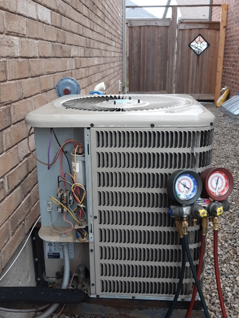 Air conditioning matinace on a goodman VSX13024 in Bradford checking capacitor and electrical components as well as the refrigerant R410A