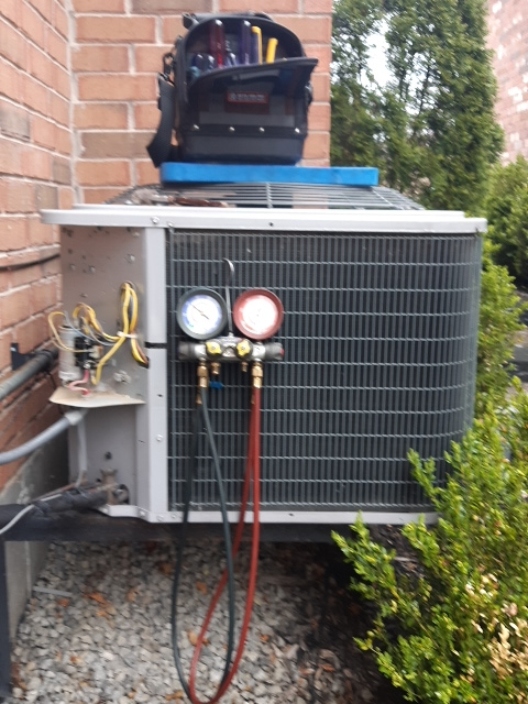 Brampton, ON - In caladon working on a carrier ac unit
