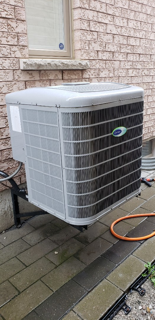 Vaughan, ON - Performing yearly maintenance on a Carrier 3 ton air conditioner in Vaughan.