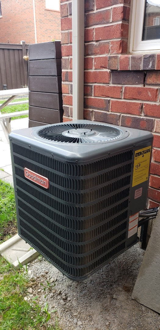 Milton, ON - Performing yearly maintenance on a Goodman 2 ton air conditioner in Milton.