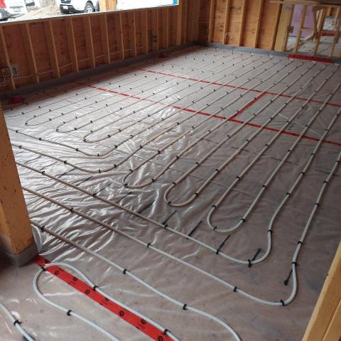 Innisfil, ON - Completing a rough-in of the infloor heating for a hydronics system for a custom home in Innisfil, ON.