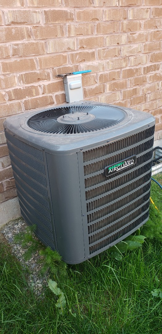 Milton, ON - Performing yearly maintenance on a Goodman 2 ton a/c in Milton