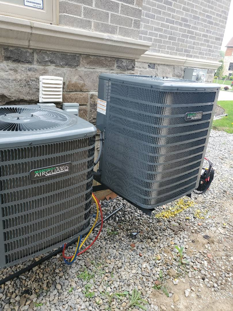 Vaughan, ON - AC Tune up on 2 Martino Airguard units in Kleinburg.