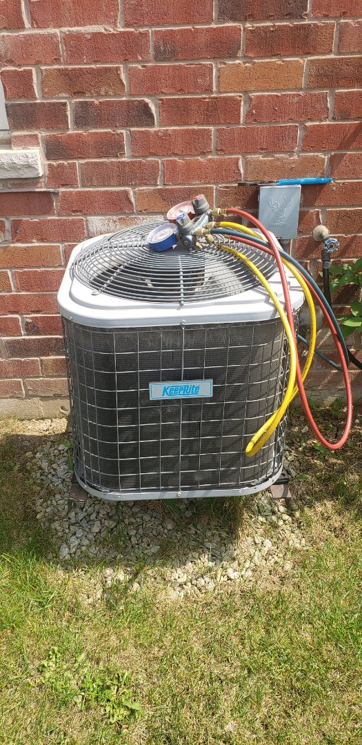 Milton, ON - Performing yearly maintenance on a Keeprite 2 ton air conditioner in Milton.