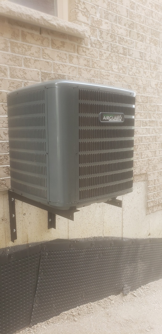 Brampton, ON - Checking the refrigerant charge on a Goodman air conditioner in Brampton.