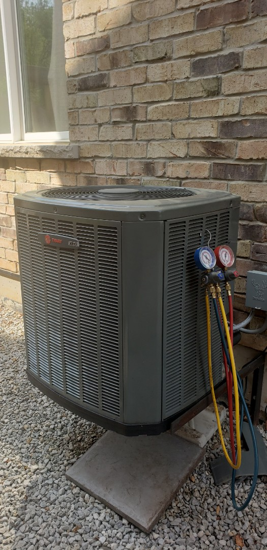 Performing yearly maintenance on a Trane 3 ton air conditioner in Georgetown.