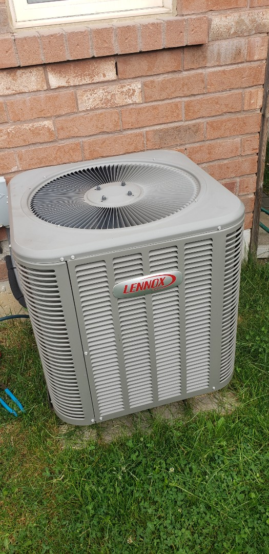 Performing yearly maintenance on a Lennox 2 ton a/c in Milton