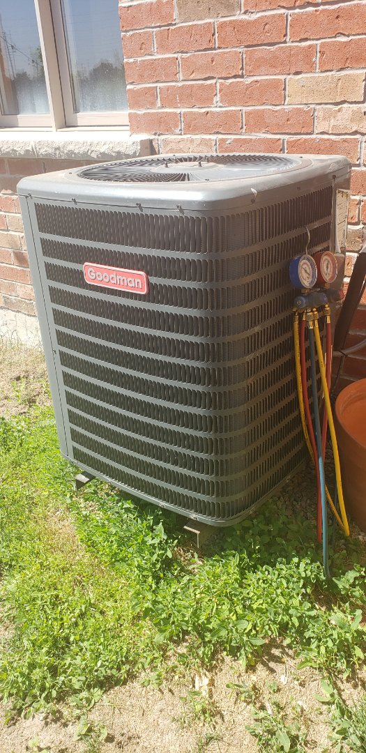 Caledon East, ON - Performing yearly maintenance on a Goodman 2.5 ton air conditioner in Caledon East.