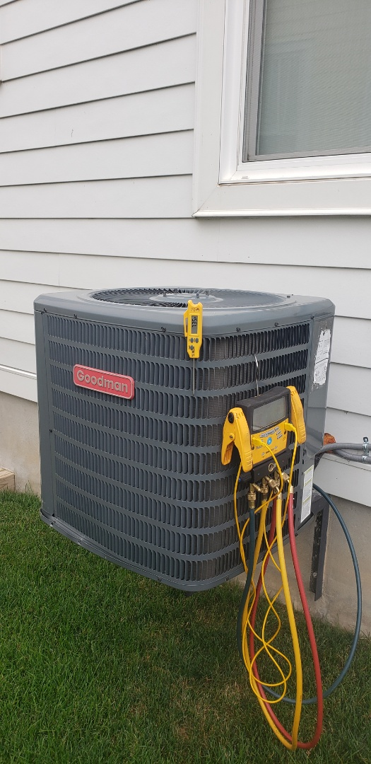 Performing yearly maintenance on a Goodman 2 ton air conditioner in Niagara on the Lake