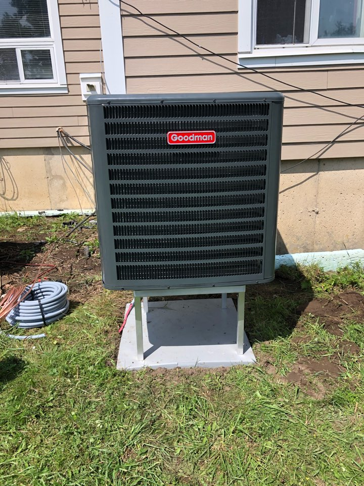 Installing a new Goodman GSZC18036 3 ton heat pump and electric furnace for a customer in Grand Valley.