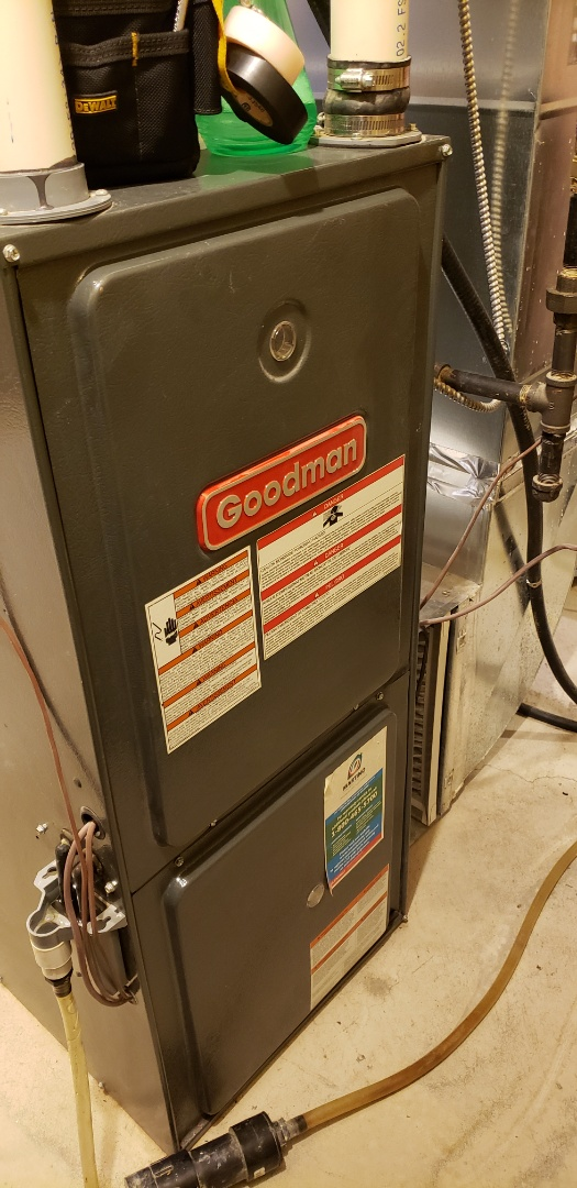 Performing yearly maintenance on a Goodman furnace in Milton.