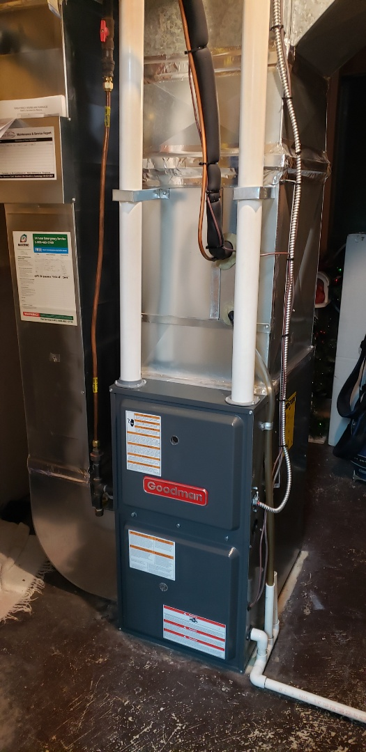 Hamilton, ON - Performing yearly maintenance on a Goodman furnace in Ancaster.