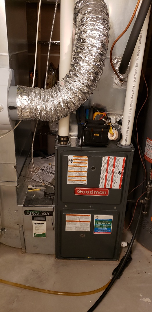 Performing yearly maintenance on a Goodman furnace in Niagara on the Lake.