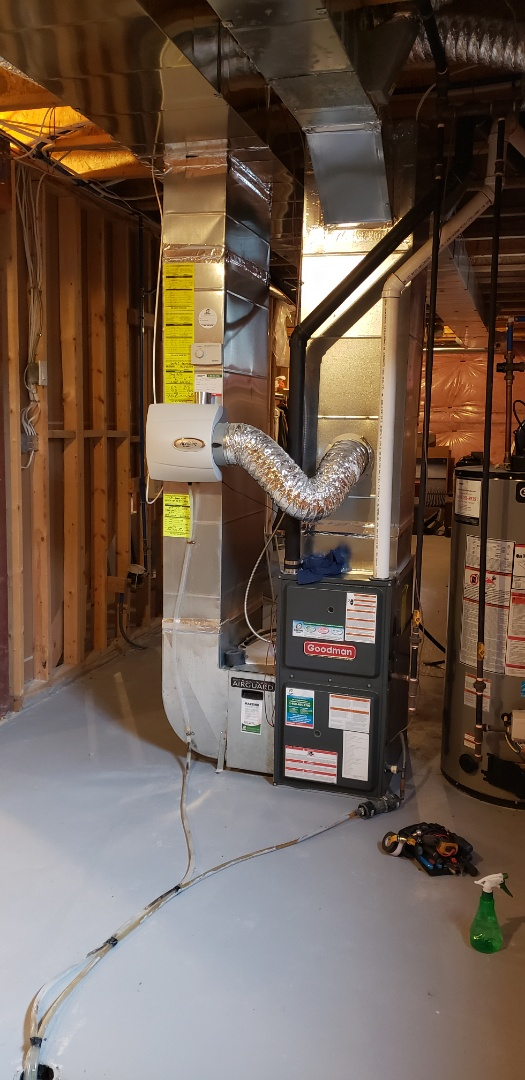 Performing yearly maintenance on a Goodman furnace in Niagara on the Lake