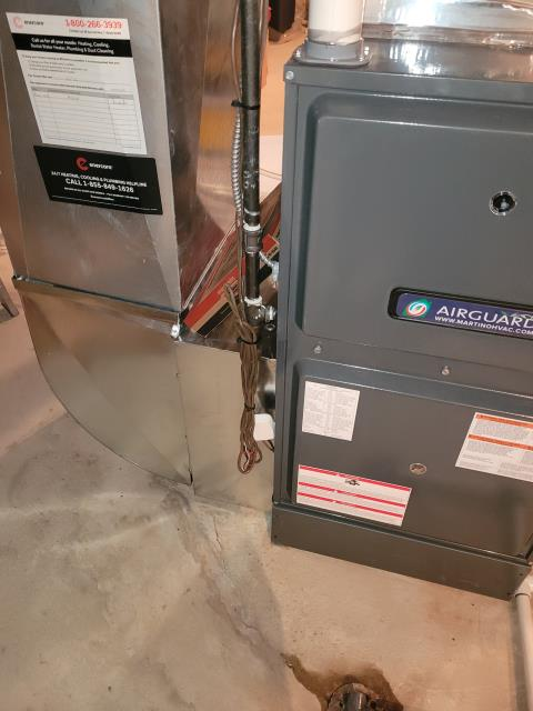 Installed a Goodman GMVC961005CN 100,000 BTU 96% efficiency 2 stage variable motor furnace in Thornhill, Ontario. Also installed an Aprilaire 600MK humidifier.