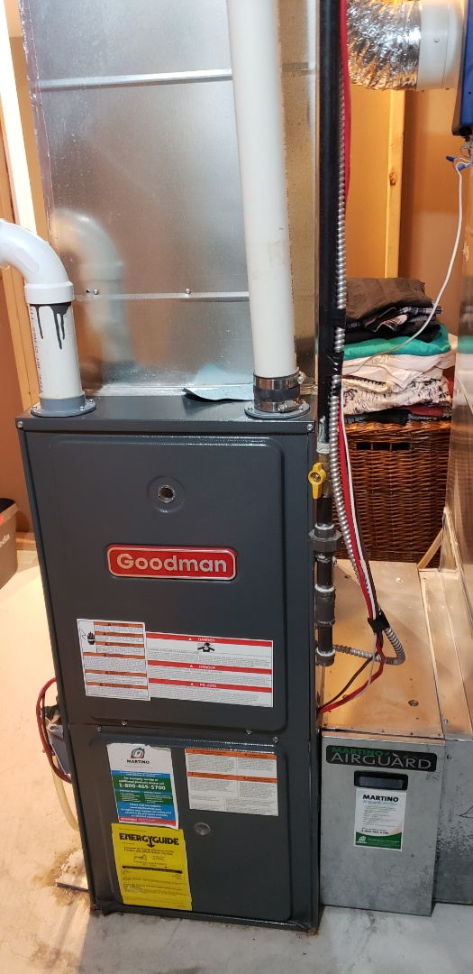 Performing yearly maintenance on a Goodman furnace in Bradford
