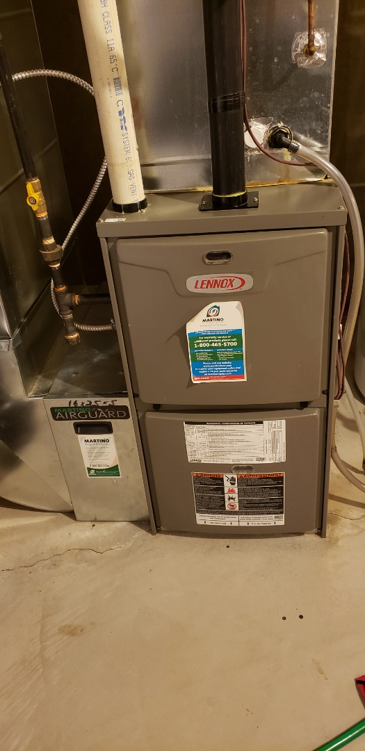 Performing yearly maintenance on a Lennox furnace in Niagara on the Lake