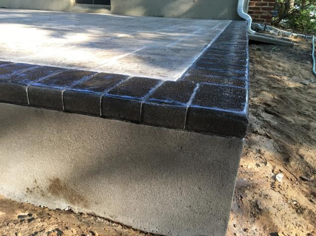 West Deptford, NJ - We are starting to frame this porch project in West Deptford, NJ this morning. The homeowners chose a beautiful stamped concrete foundation to use as the finished floor surface. It looks like real slate and brick. Notice the detail on the brick border. We cut the side of the concrete to look like real mortar joints.