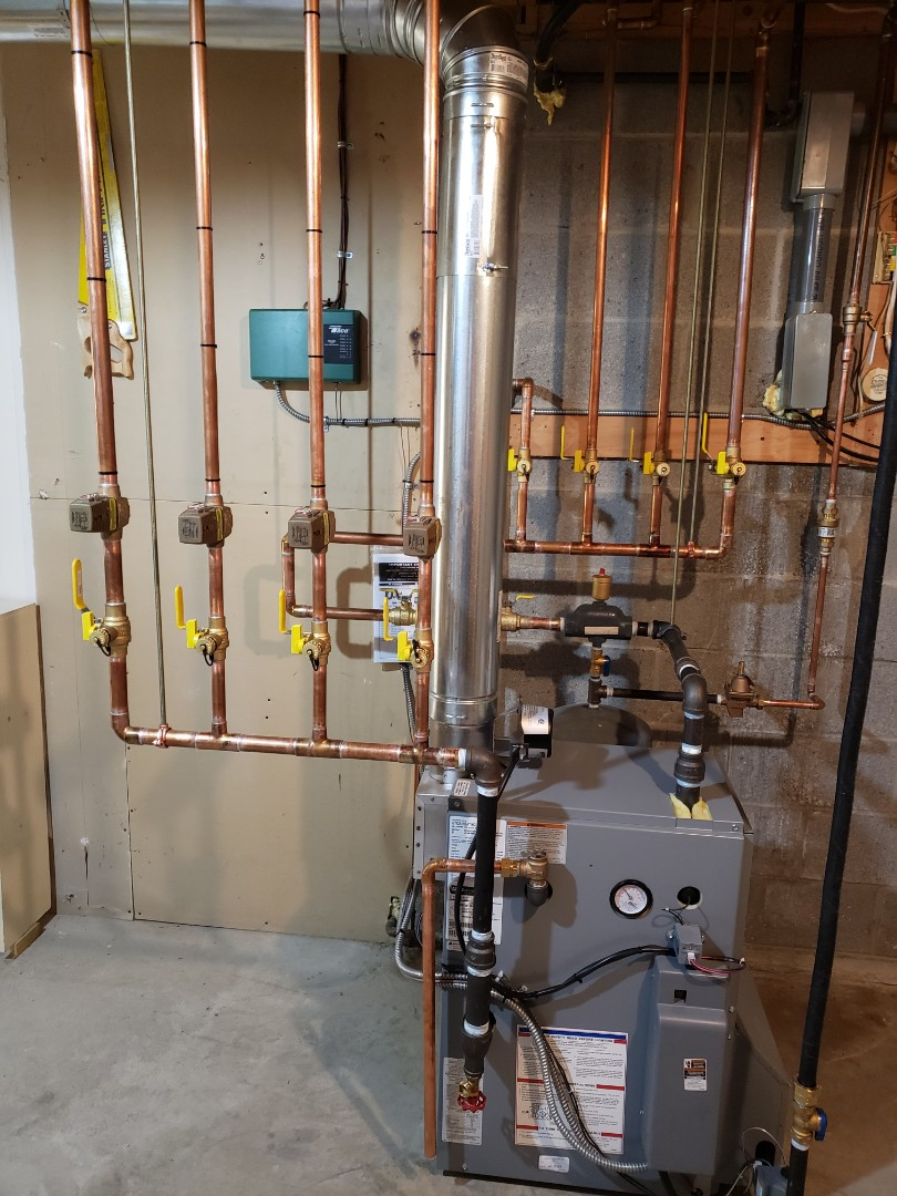 Ithaca, NY - Finish installing Utica gas fired boiler. Disconnect temporary electric water heater. Test safeties and combustion.