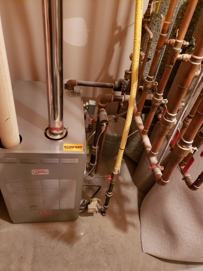 Ithaca, NY - Planned maintenance on Comfort Technology installed, gas fired, sealed combustion Utica boiler. Test safeties and combustion.