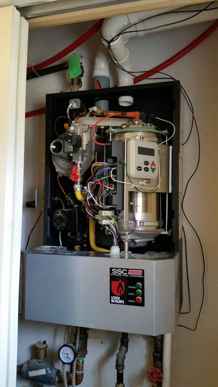 Lansing, NY - Troubleshoot improper operation on Utica wall mount condensing boiler.  Radiant floor was not operating properly.  Areas were cold.  Connect outdoor sensor.  Adjust boiler outdoor reset curve.