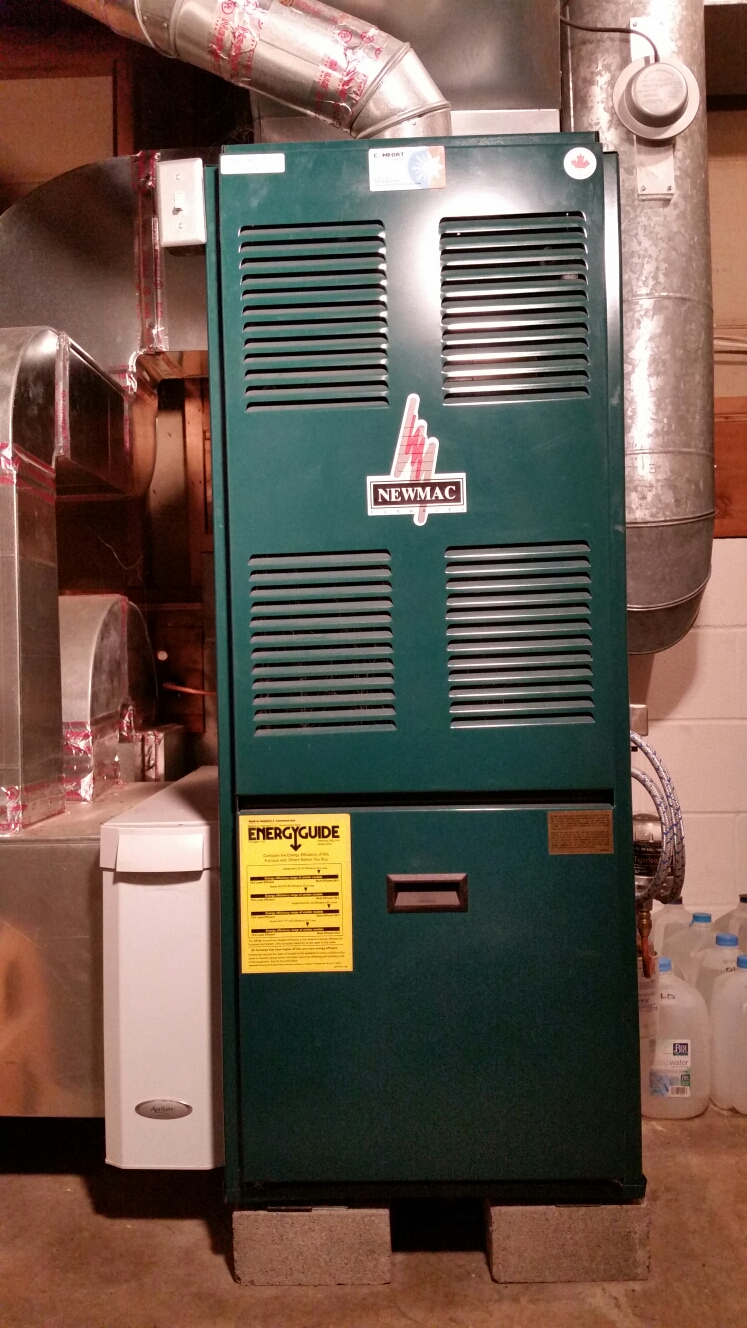 Freeville, NY - Planned maintenance on Comfort Technology installed oil fired Newmac furnace with Aprilaire air cleaner and Arzel zone control.