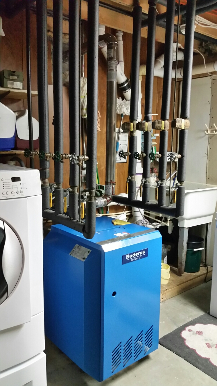 Lansing, NY - Service Comfort Technology installed gas fired Buderus boiler. Test safeties and combustion. Also service Comfort Technology installed Fujitsu mini split air conditioning system.