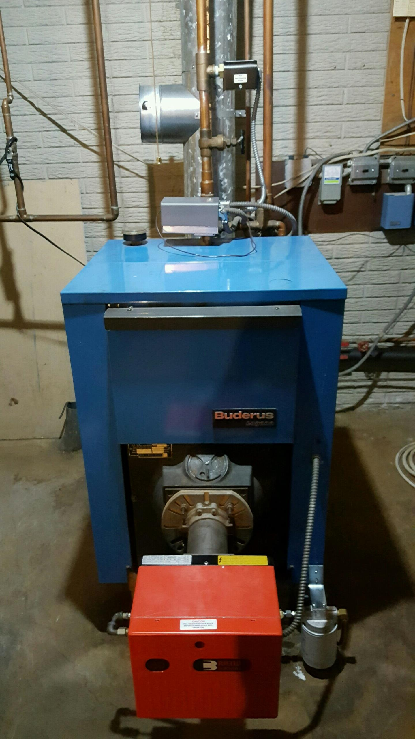Ithaca, NY - Planned maintenance on oil fired Buderus boiler with Riello burner. Test safeties and combustion. Install low water cut off and barometric damper.