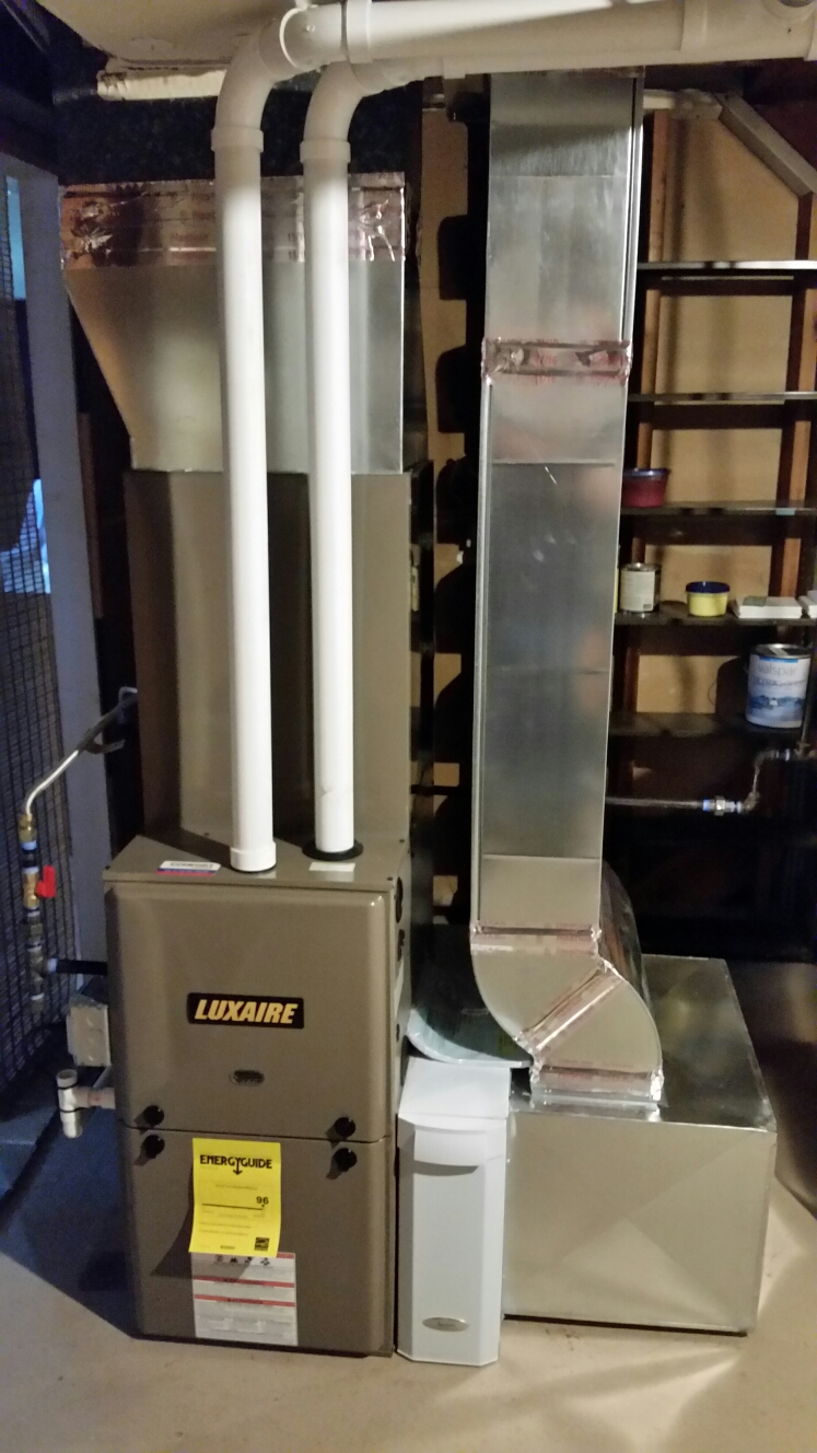 Cortland, NY - Finish installation Luxaire high efficiency 2 stage furnace with Aprilaire high efficiency air cleaner and air conditioning.