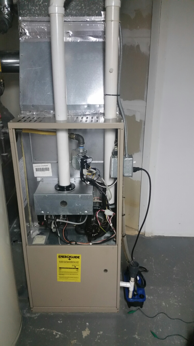 Ithaca, NY - Service Comfort Technology installed, gas fired, two stage, high efficiency York furnace. Test safeties and combustion.