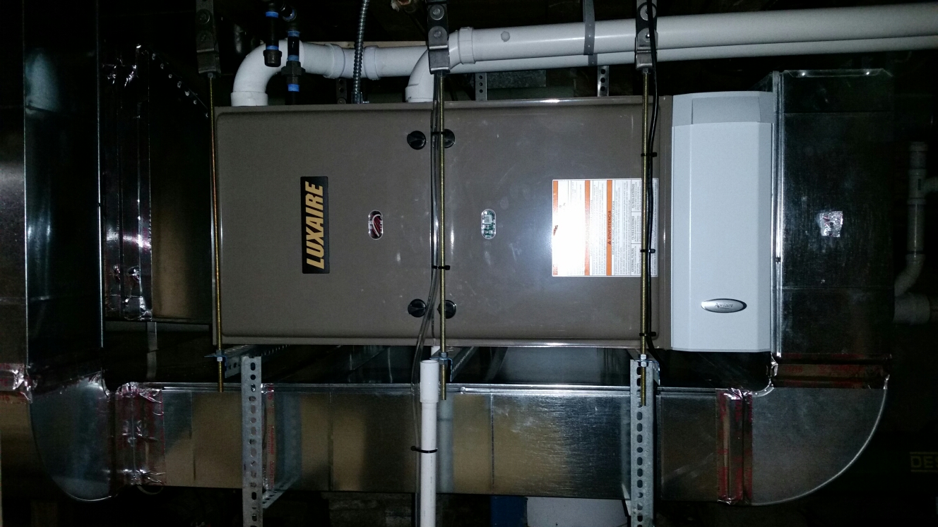 Freeville, NY - Finish installation of high efficiency gas fired Luxaire furnace.