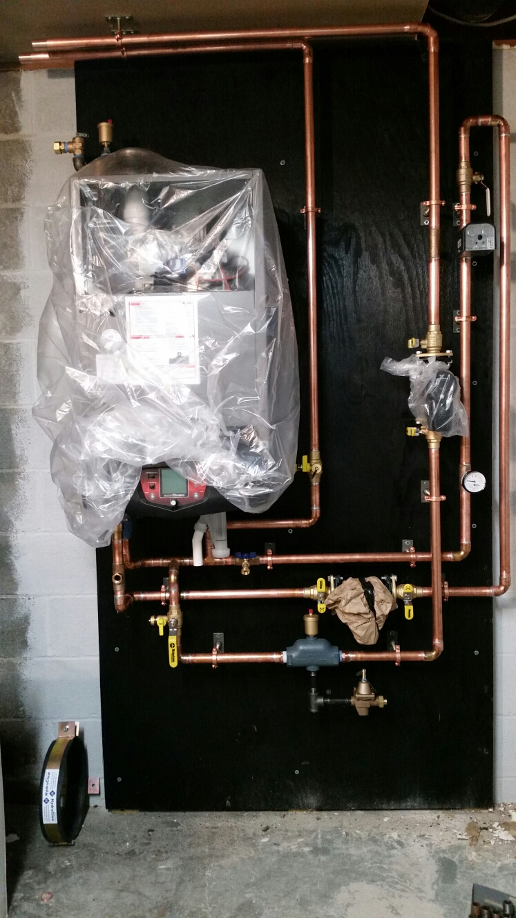 Ithaca, NY - Installing Lochinvar Knight high efficiency gas fired boiler.