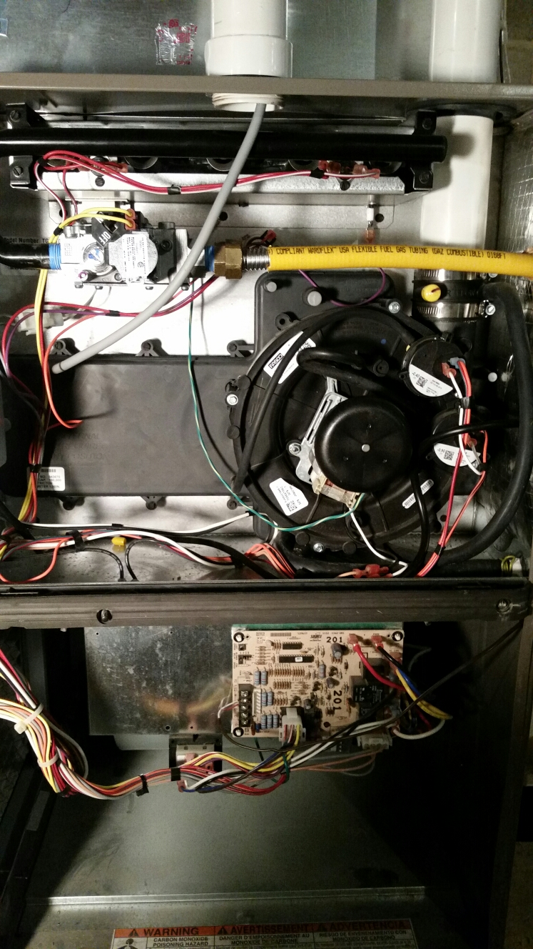 Ithaca, NY - Planned maintenance on Luxaire, high efficiency,  gas fired furnace. Test safeties and combustion