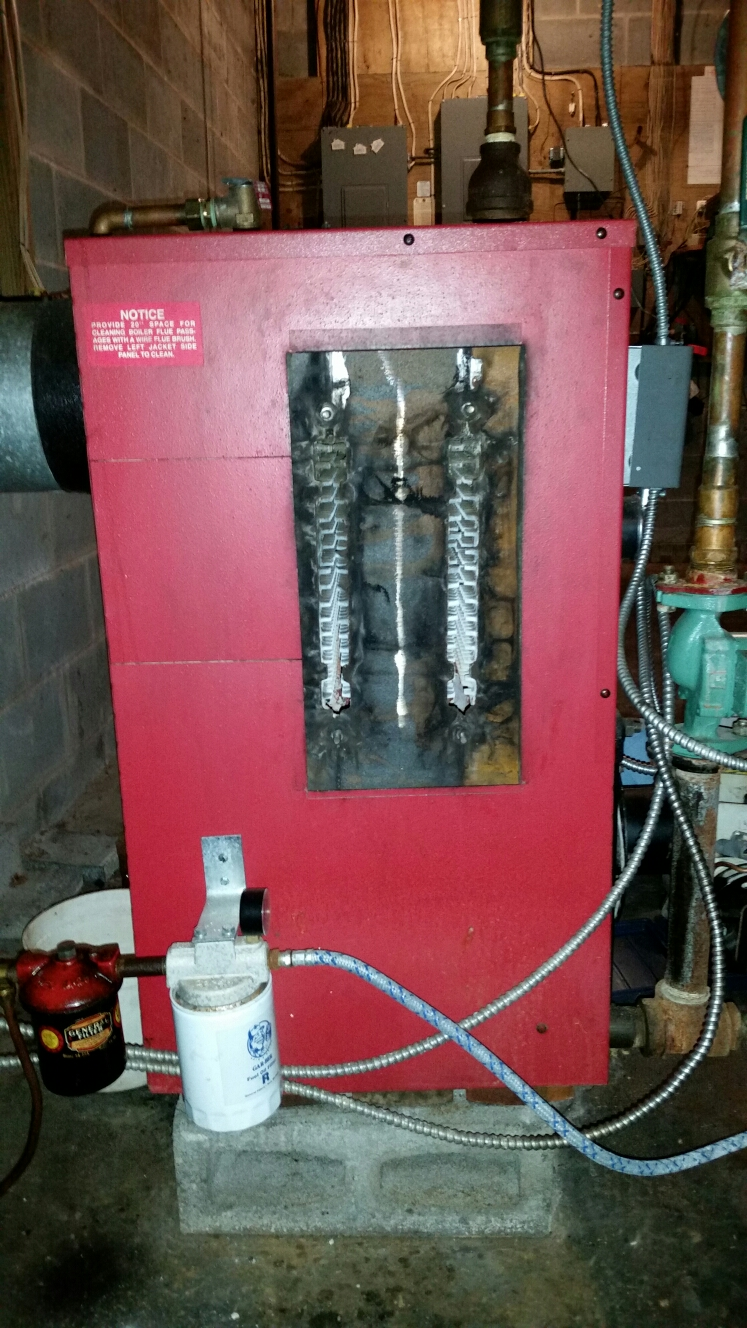 Groton, NY - Scheduled maintenance on oil fired Smith boiler. Test safeties and combustion.