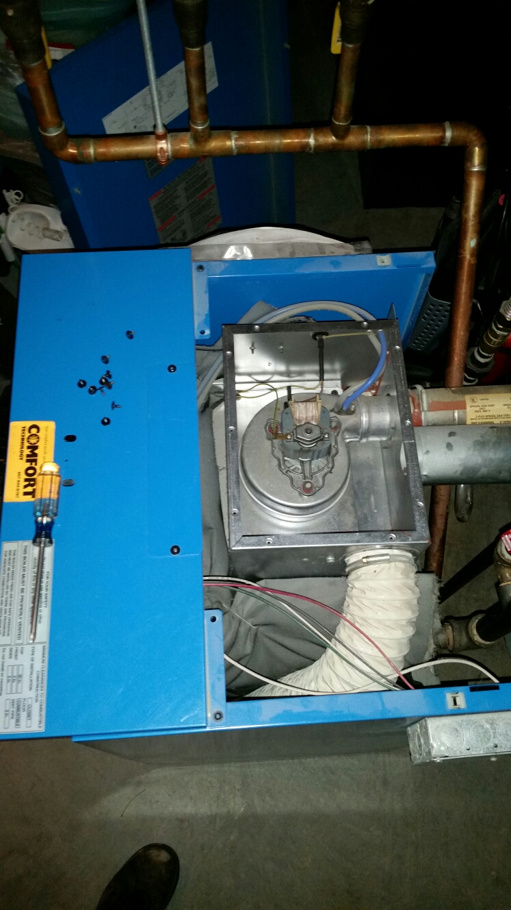 Ithaca, NY - Clean combustion air intake during planned maintenance of Buderus sealed combustion boiler.