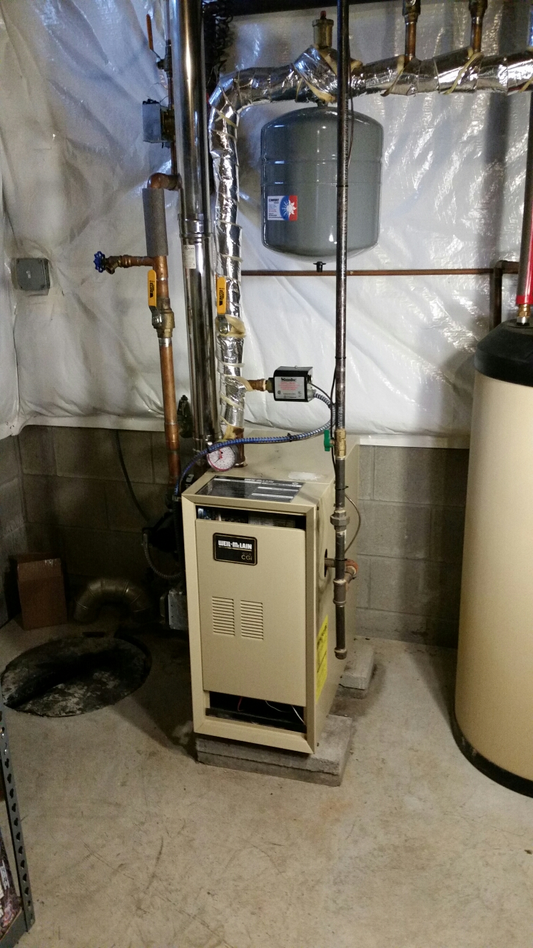 Ithaca, NY - Planned maintenance on Weil McLain gas fired boiler. Test safeties and combustion.