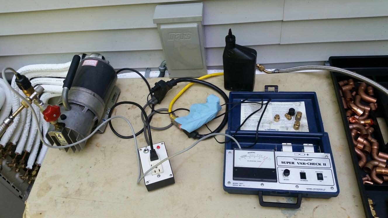 Groton, NY - Pulling vacuum on one of four zones on a newly installed Fujitsu mini split system.