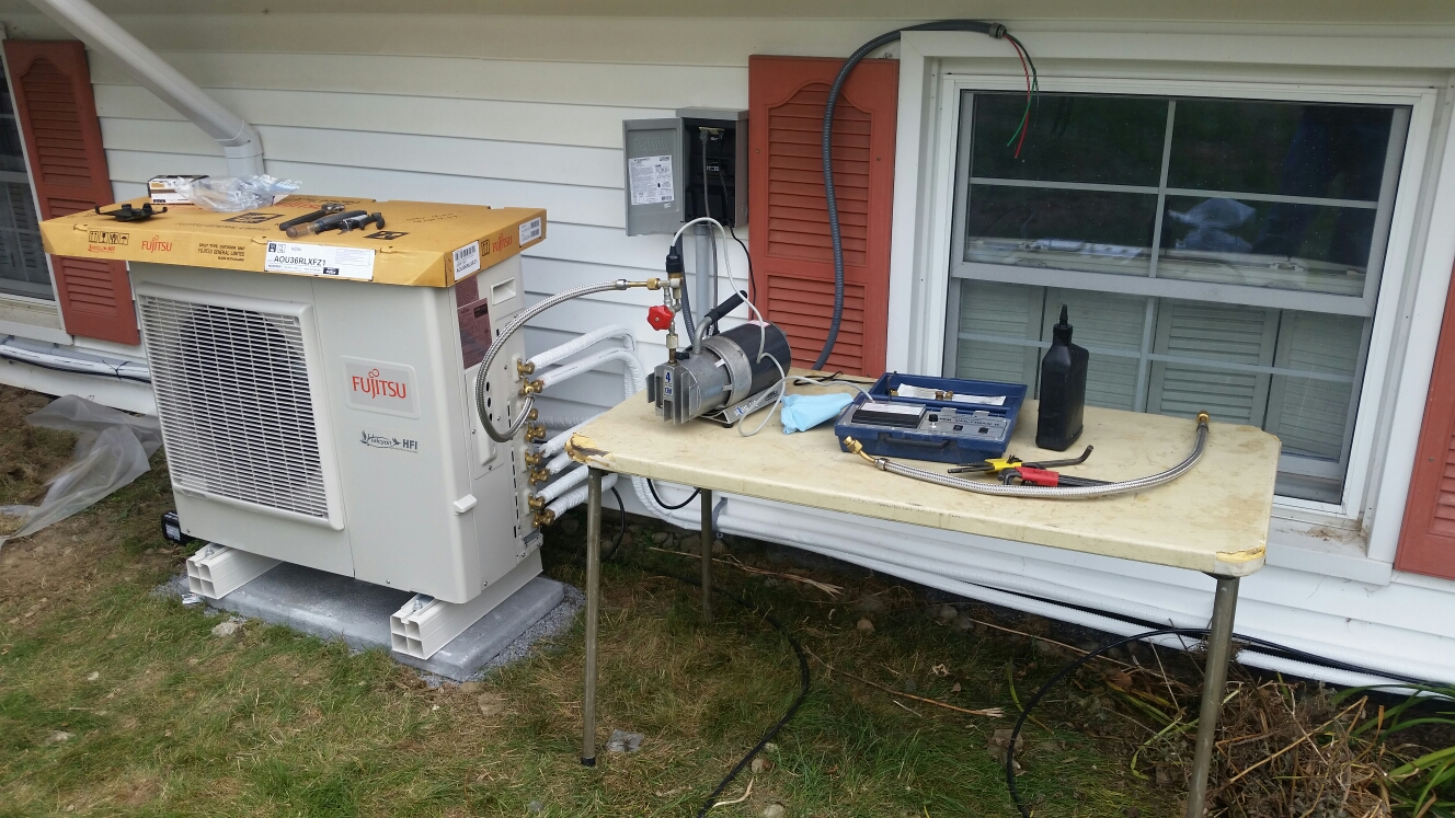 Cortland, NY - Putting a vacuum on new Fujitsu mini split air conditioning system.