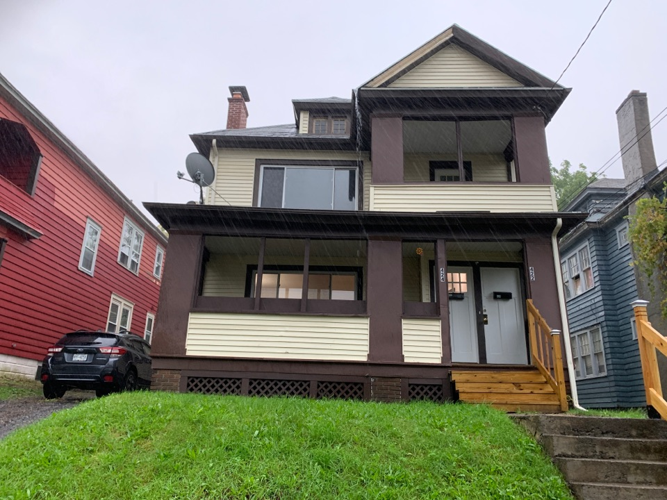 Syracuse, NY - New roof estimate.  Cedar shake roof deck with multiple layers.