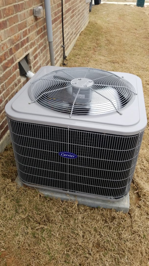 Heath, TX - Working on a Carrier heat pump for a family in Forney