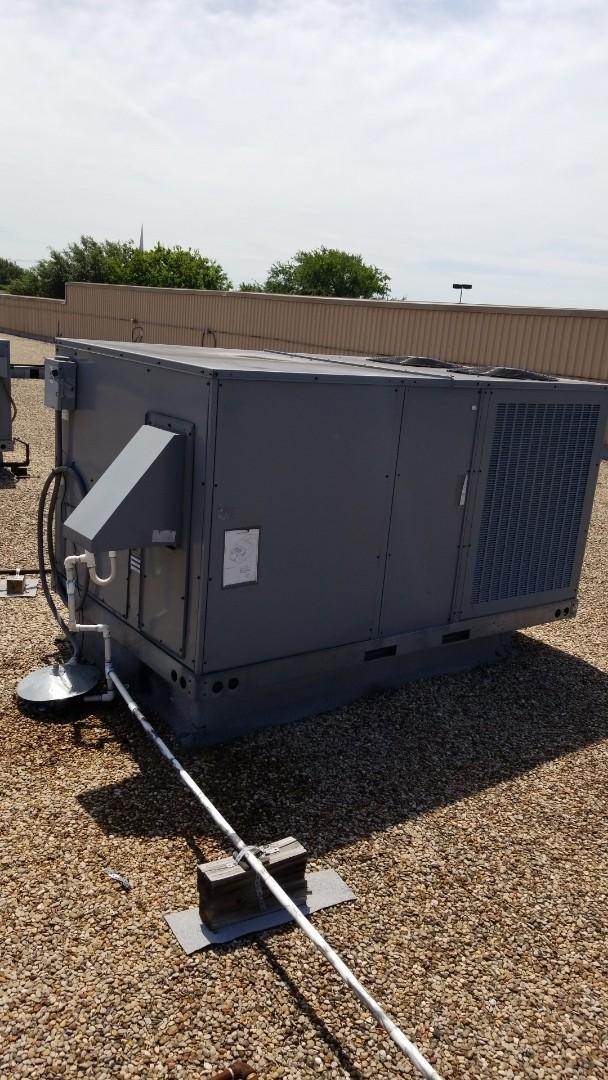 Grand Prairie, TX - Clearing the drain line on an air conditioner in Grand Prairie