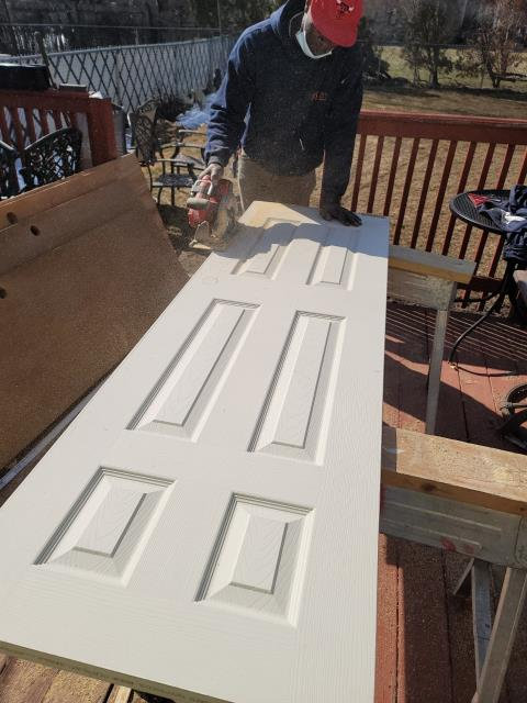 Evanston, IL - Installing 11 new doors throughout the house.