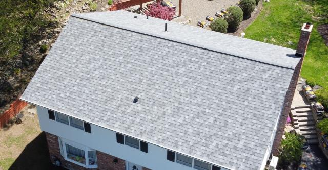 Monroe, NY - Stunning installation job done by our crew on a roof in Monroe. The shingles we installed are Owens Corning Duration Shingles in Slatestone Gray.