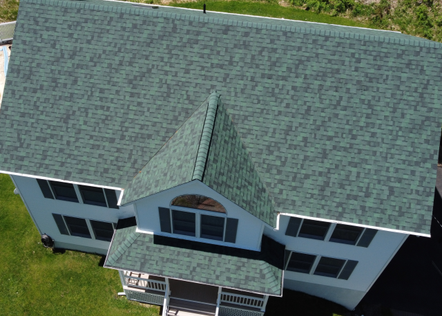 Monroe, NY - Amazing job transforming this roof by our crew. Our team goes above and beyond to make your dream home a reality. The shingles featured here are Owens Corning TruDefinition Duration in Chateau Green.