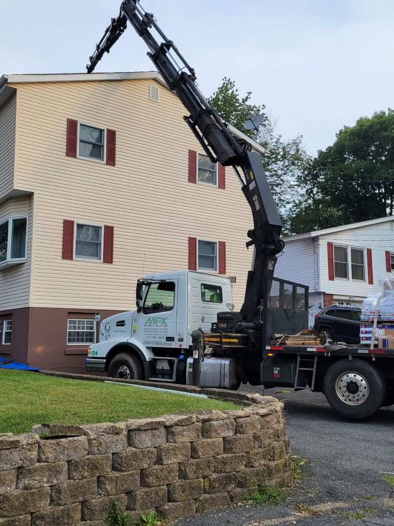 Roxbury Township, NJ - Loading materials on roof. Installing a new GAF Timberline HDZ Roof in Charcoal