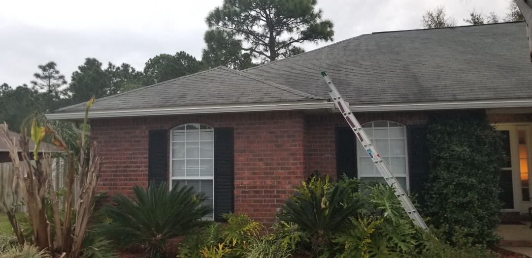 Navarre, FL - Measure roof,three tab shingles, vinyl siding chimney white,white eave metal,lace valleys,some wood damage or rot, gray shingles ,6 on 12 pitch ,3 pipe flanges and 1 power pole flange,bay window at back of home
