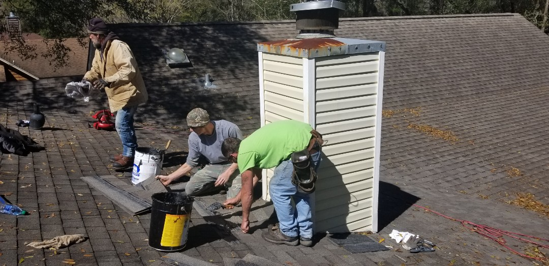 Repair winding down  Flash chimney  Replace wood decking 3 sheets and 40 ft 2x4 lumber Tamko 30 yr shingles weathered wood Ice and water shield underlayment  2 ea pipe boot flanges steel base