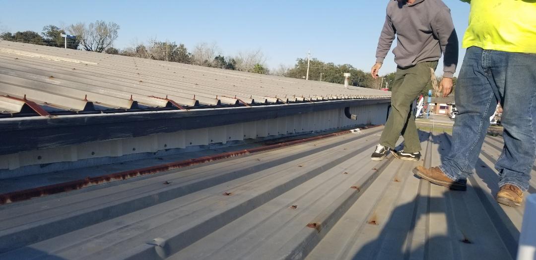 Metal roof repair with new sidewall panels R panels  Tpo membrane,metal wall panels,vesico,duro last,