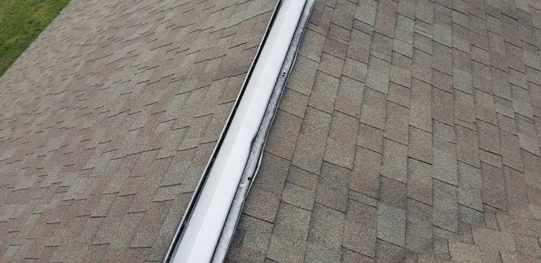 Roof inspection,dimensional shingles roof,plastic pipe boots crack,metal ridge vent we never use this type anymore we always use lomanco shingle over type